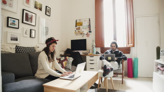 young couple working from home - desktop pc stock videos & royalty-free footage