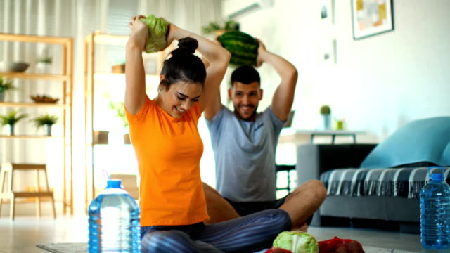 young couple working out at home. - sitting on floor stock videos & royalty-free footage