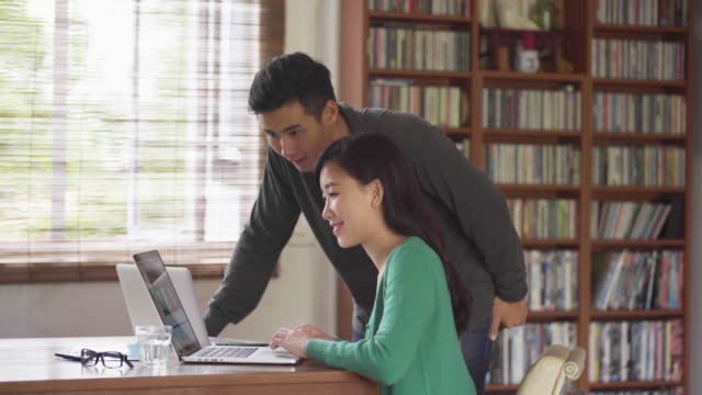 WS young couple working together on a laptop