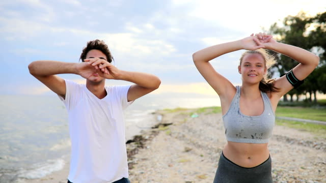 Young couple workout training on beach