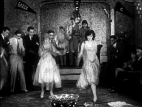 b/w 1926 young couples dancing charleston indoors (college party) / newsreel - 1920 stock-videos und b-roll-filmmaterial