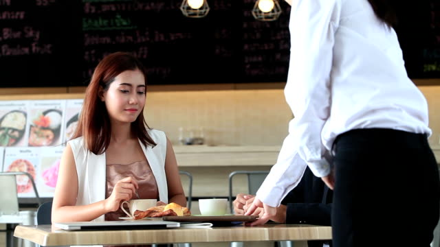young couples eat and drink in the coffee shop - coffee drink stock videos and b-roll footage