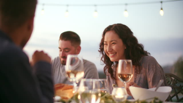 young couples eating at a dinner party outdoors - dinner party stock videos & royalty-free footage