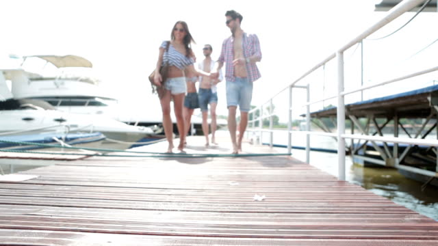 stockvideo's en b-roll-footage met hd: young couples going on yacht. - jachtvaren
