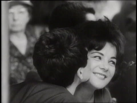vidéos et rushes de young couples talk and kiss. - 1960