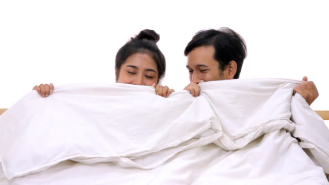 young couples under duvet in their bed.hd format. - duvet stock videos & royalty-free footage