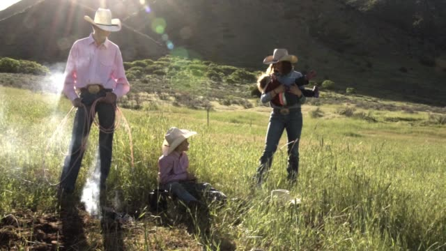 young cowboy family at campfire - ranch stock videos & royalty-free footage