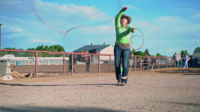 young cowgirl training lassoing on a ranch in usa - cowgirl stock videos & royalty-free footage