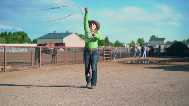 young cowgirl training lassoing on a ranch in usa - cowboy hat stock videos & royalty-free footage