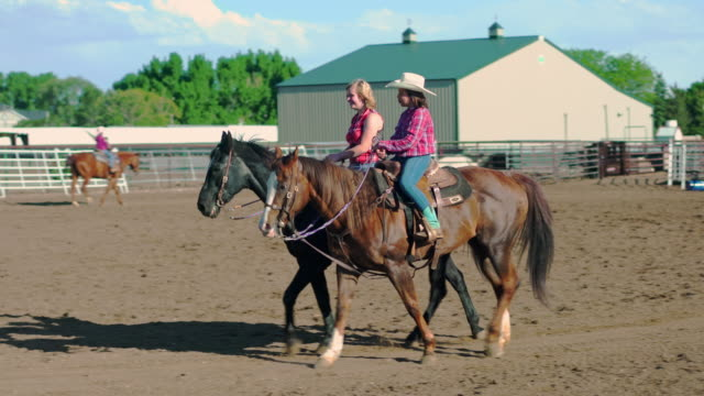 young cowgirls riding horses on a ranch - cowgirl stock videos & royalty-free footage