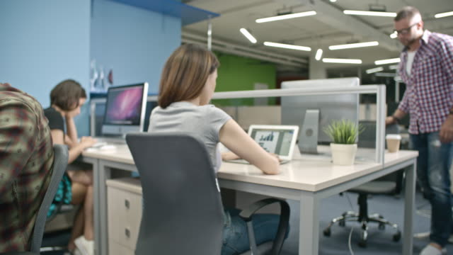 Young creative business people working in modern office