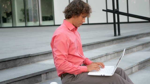 Young creative business person doing business during coffee break