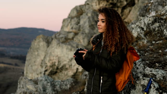 young curly hair female hiking on the mountain peak. - curly stock videos & royalty-free footage