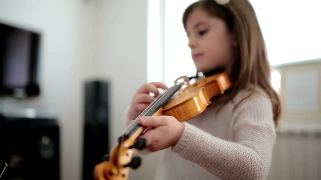 young cute girl playing violin at home - violin stock videos & royalty-free footage