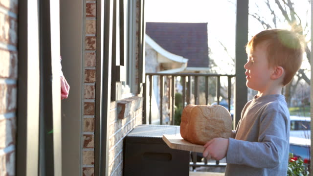 young cute redhead kid bringing homemade bread to neighbor's door - sharing stock videos & royalty-free footage
