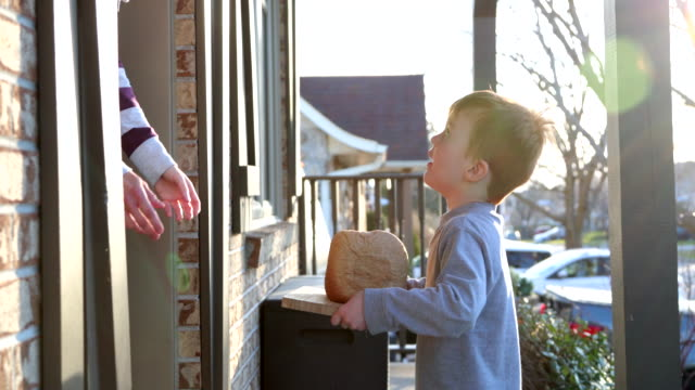 young cute redhead kid bringing homemade bread to neighbor's door - neighbor stock videos & royalty-free footage