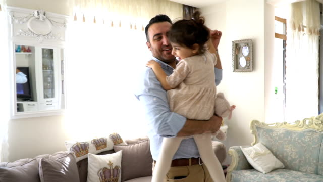 young dad and his daughter dancing at home - middle east stock videos & royalty-free footage
