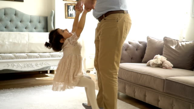 young dad and his daughter dancing at home - living room stock videos & royalty-free footage