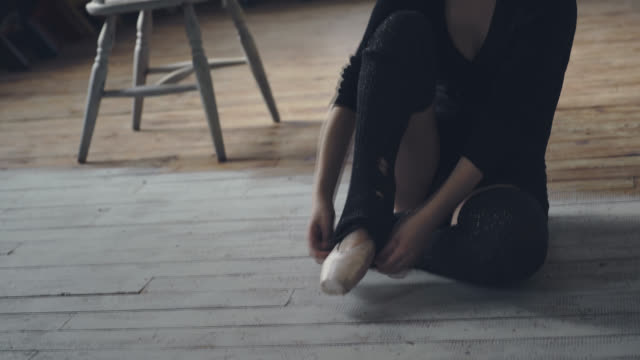 young dancer fitting her ballet shoes - ballet shoe stock videos and b-roll footage