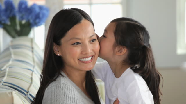 MS PAN Young Daughter Whispering to Mother, Hugging Each Other / Eastville, Virginia, USA