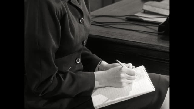cu young deaf woman writing on notepad / united states - deafness stock videos and b-roll footage