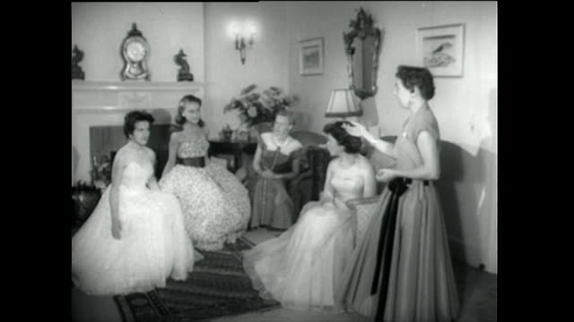 young debutantes learn how to curtsey in a dress; 1955 - repetition stock videos & royalty-free footage
