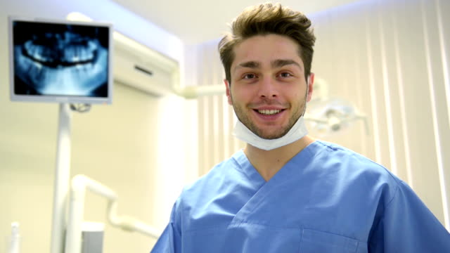 young dentist posing - lab coat stock videos & royalty-free footage