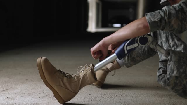 young depressed soldier with amputee leg - amputee stock videos & royalty-free footage