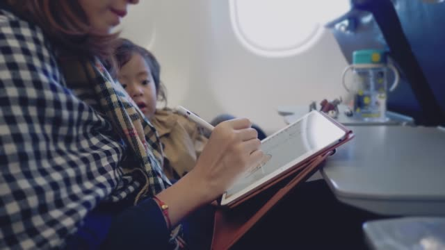 young designer woman using graphic tablet with her son - illustrator stock videos & royalty-free footage