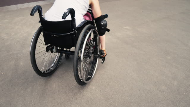 young determined woman in wheelchair in skate park - orthopedic equipment stock videos & royalty-free footage