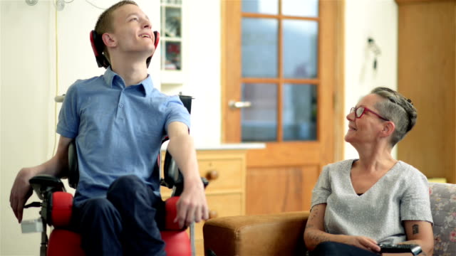 Young disabled son and his mother