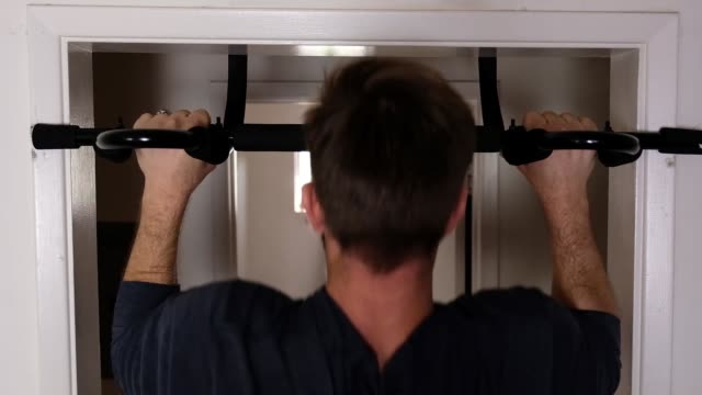 young does pull-ups at home - pull ups stock videos & royalty-free footage