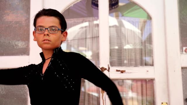 vídeos de stock e filmes b-roll de young elegant romantic boy have a latino dance performance - arte, cultura e espetáculo