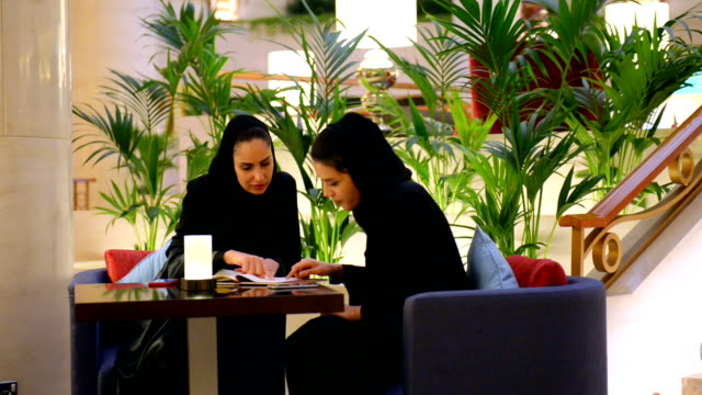 young emirati woman in a luxury cafe - middle eastern ethnicity stock videos & royalty-free footage