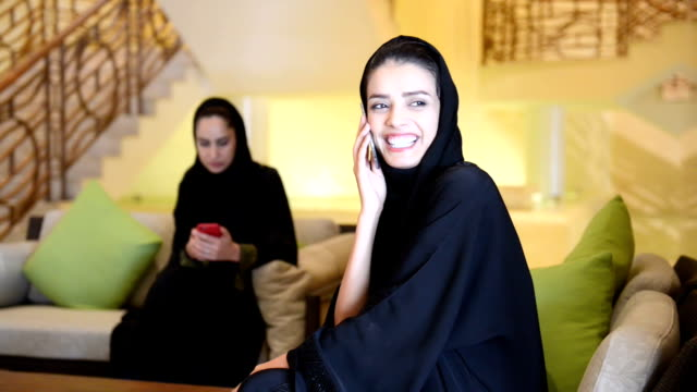 young emirati women in the spa lobby - hijab stock videos and b-roll footage