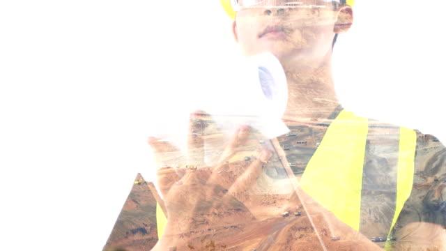 young engineer bei erzmine hintergrund. - digital composite stock-videos und b-roll-filmmaterial