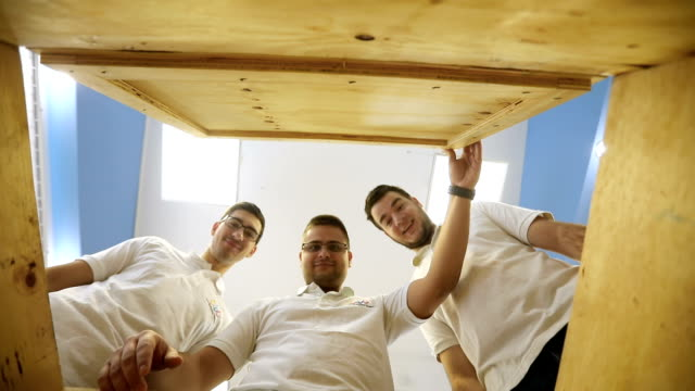 Young Engineers Open Wooden Crate