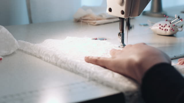 young entrepreneur sewing wedding dress - dress stock videos & royalty-free footage