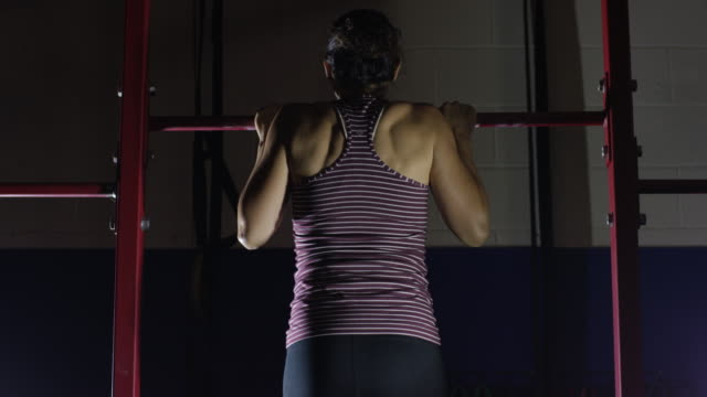 young ethnic female doing pull ups - chin ups stock videos and b-roll footage