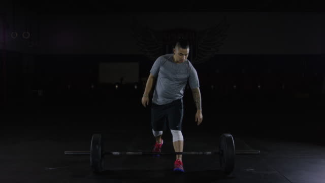 Young ethnic male doing gym