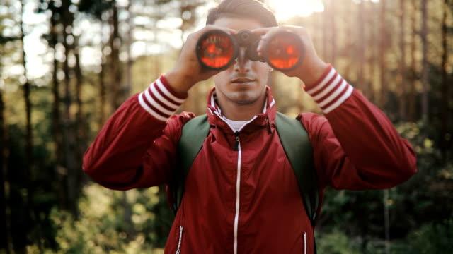 young explorer looking through binoculars - binoculars stock videos & royalty-free footage