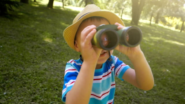 young explorer - binoculars stock videos & royalty-free footage