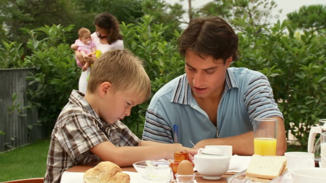 hd dolly: young family after breakfast - young family stock videos & royalty-free footage