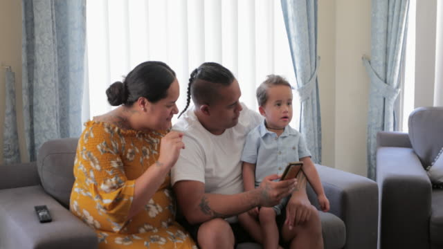 young family at home - pacific islander couple stock videos & royalty-free footage