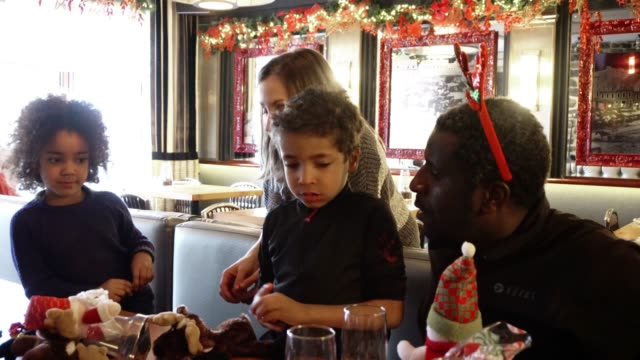 young family christmas market restaurant playing - mixed race person stock videos & royalty-free footage