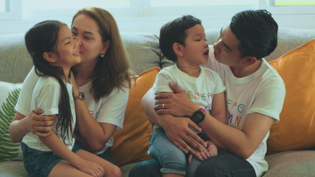 young family enjoying quality time together - hugging self stock videos & royalty-free footage