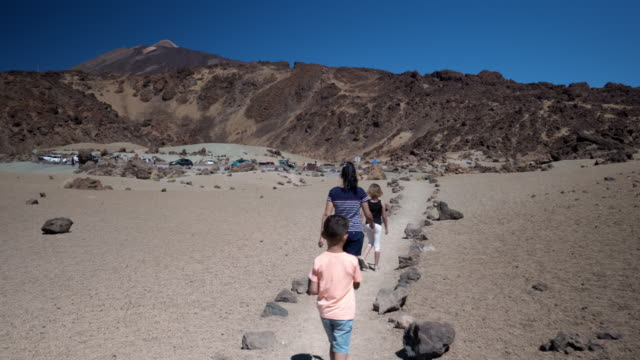 young family exploring volcanic mountain teide in tenerife spain 4k video - volcano stock videos & royalty-free footage