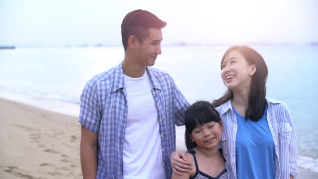 cu young family having fun on the beach - young family stock videos & royalty-free footage