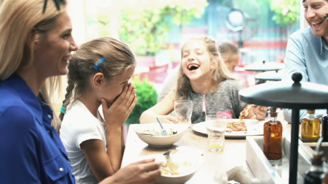young family having lunch. - ristorante video stock e b–roll