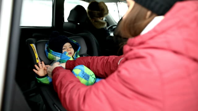 young family in the car - vehicle seat stock videos & royalty-free footage